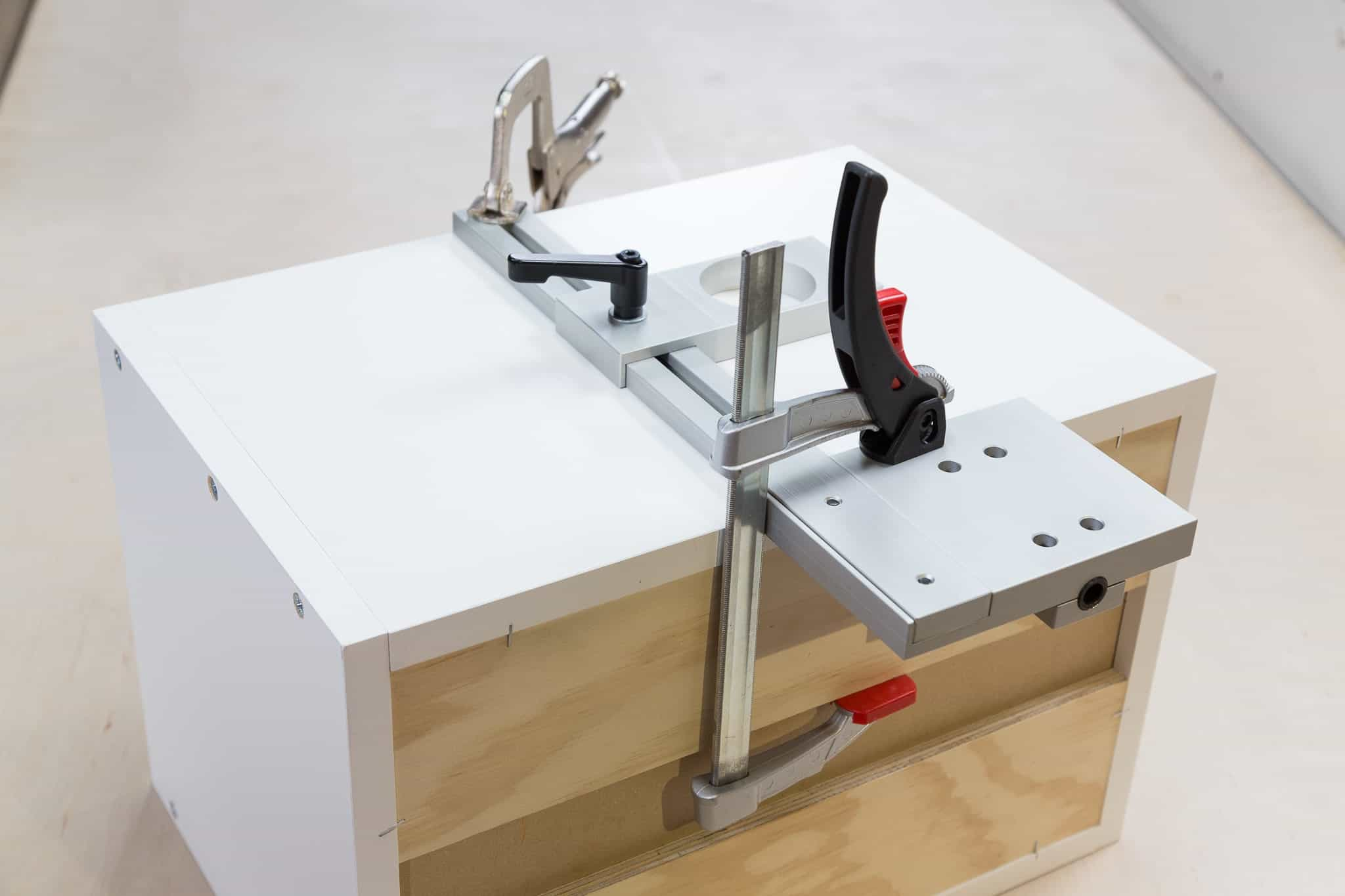 TP-PLJ Puck Light Jig clamped on cabinet
