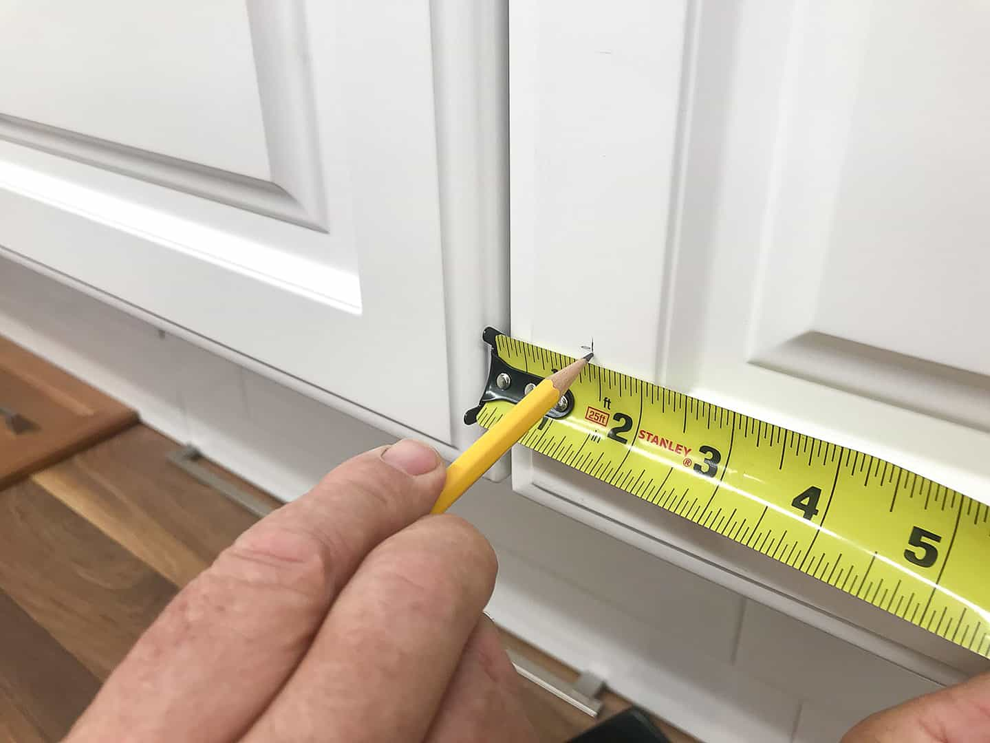 handle installation on cabinet door with TP-1934 Cabinet Hardware Jig (step 4)