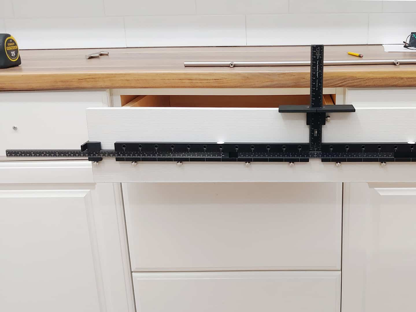 long handle installation on cabinet drawer with TP-1934 Cabinet Hardware Jig (step 4)