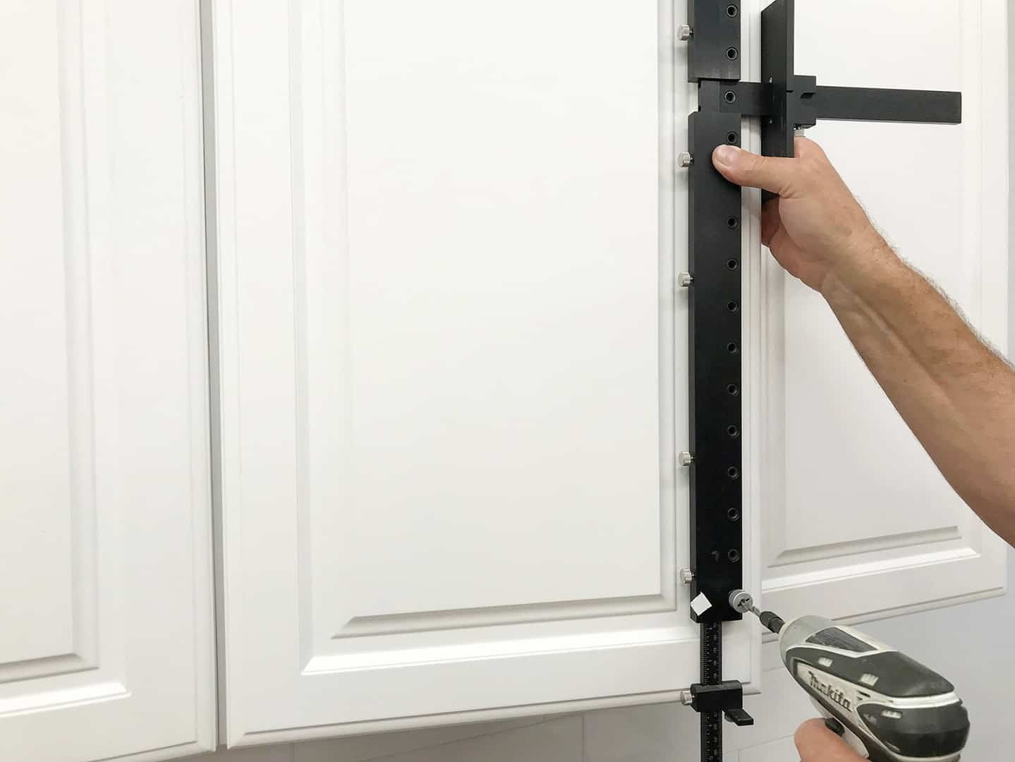 long handle installation on tall cabinet doors with TP-1935 Cabinet Hardware Jig (step 12)