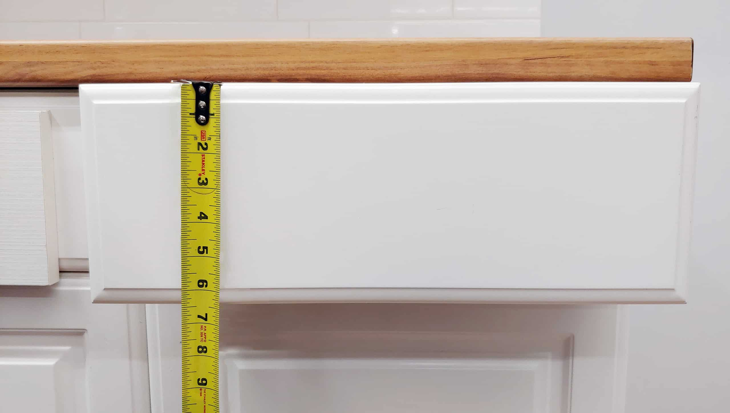 tape measuring height on cabinet drawer front
