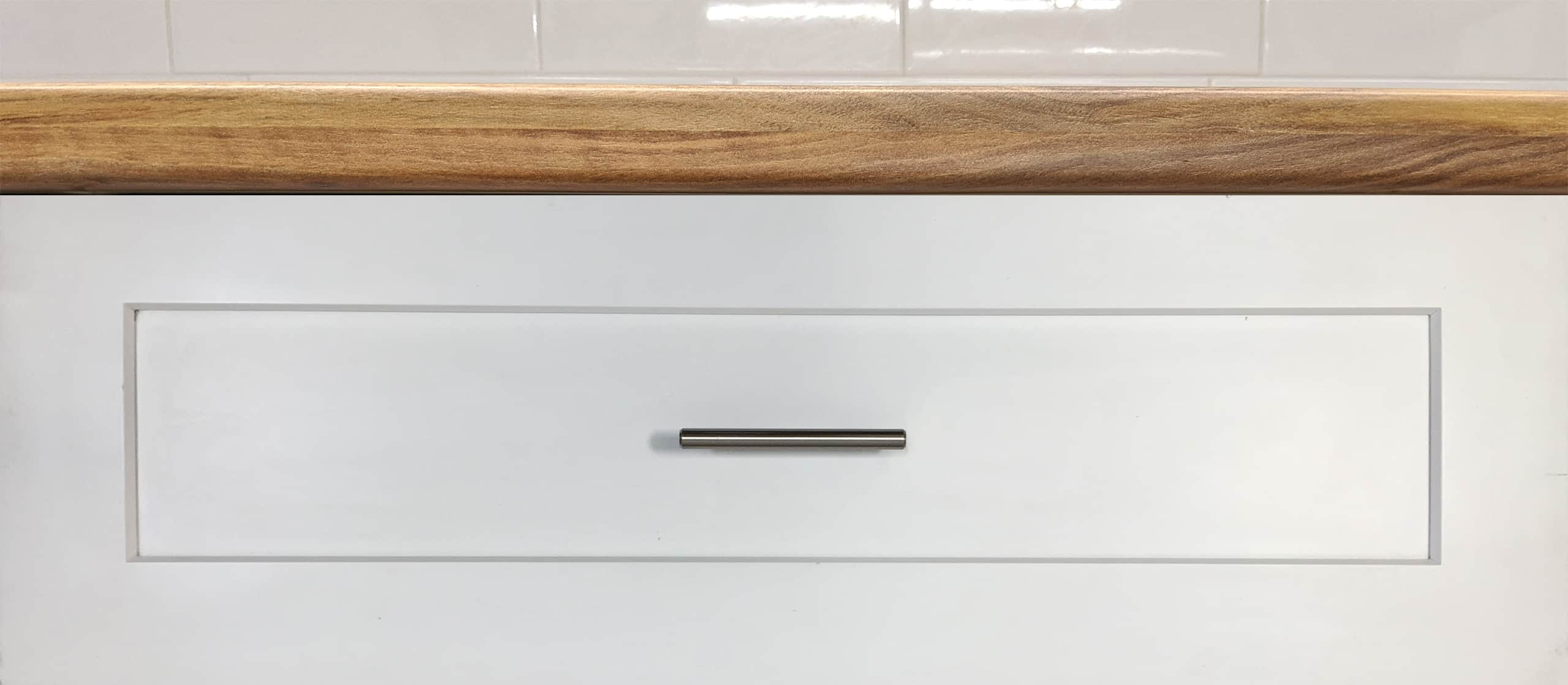 Shaker style cabinet drawer front handle pull installed