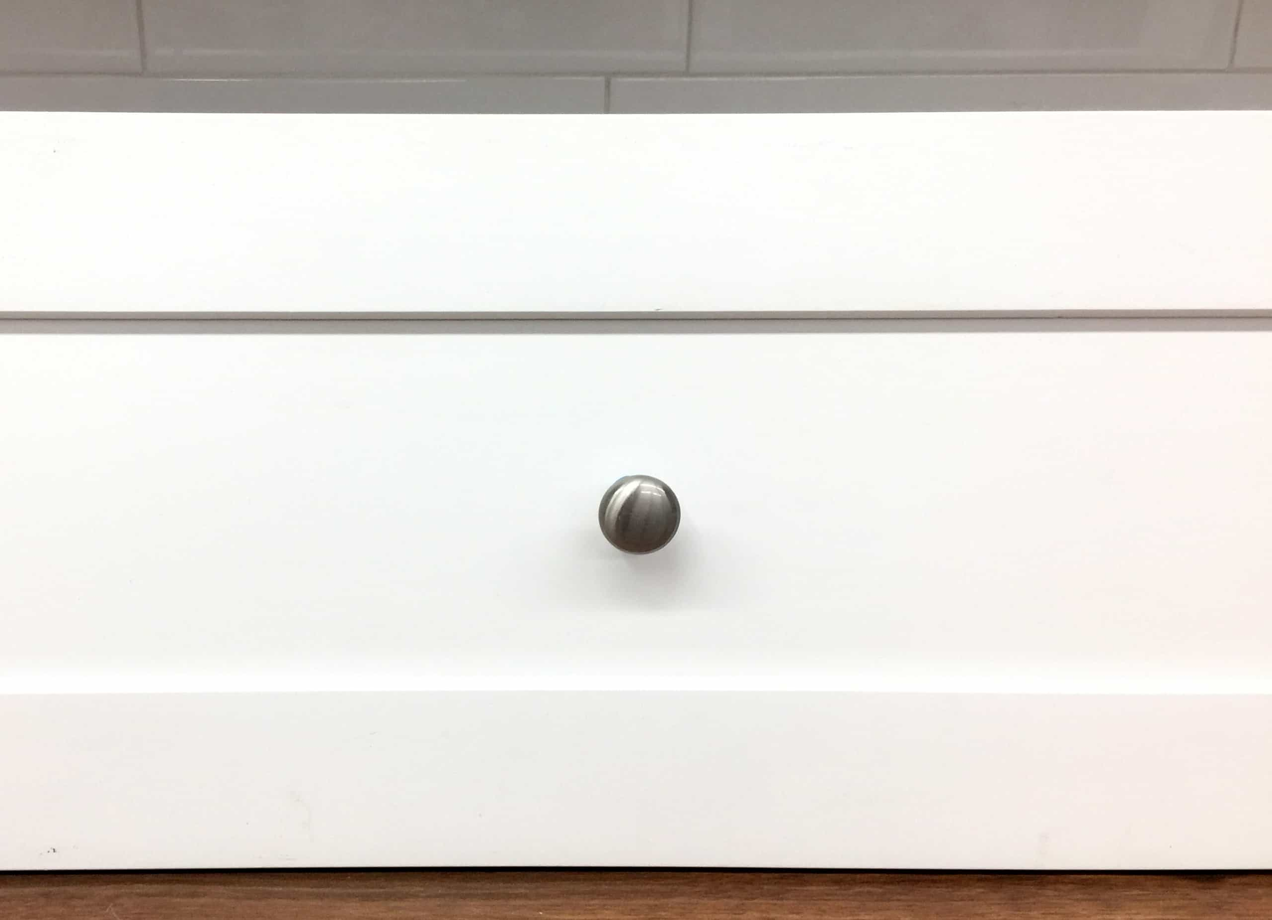 knob installed shaker style cabinet drawer front