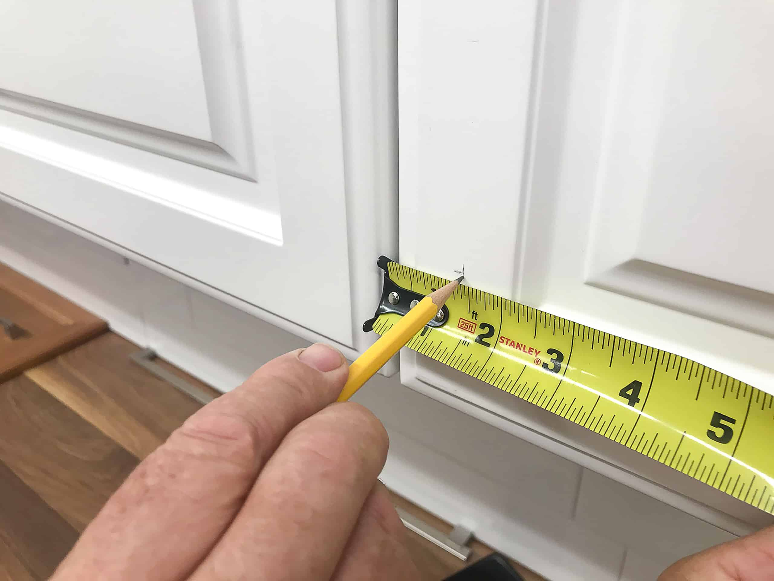 white kitchen cabinet door tape measurement marking